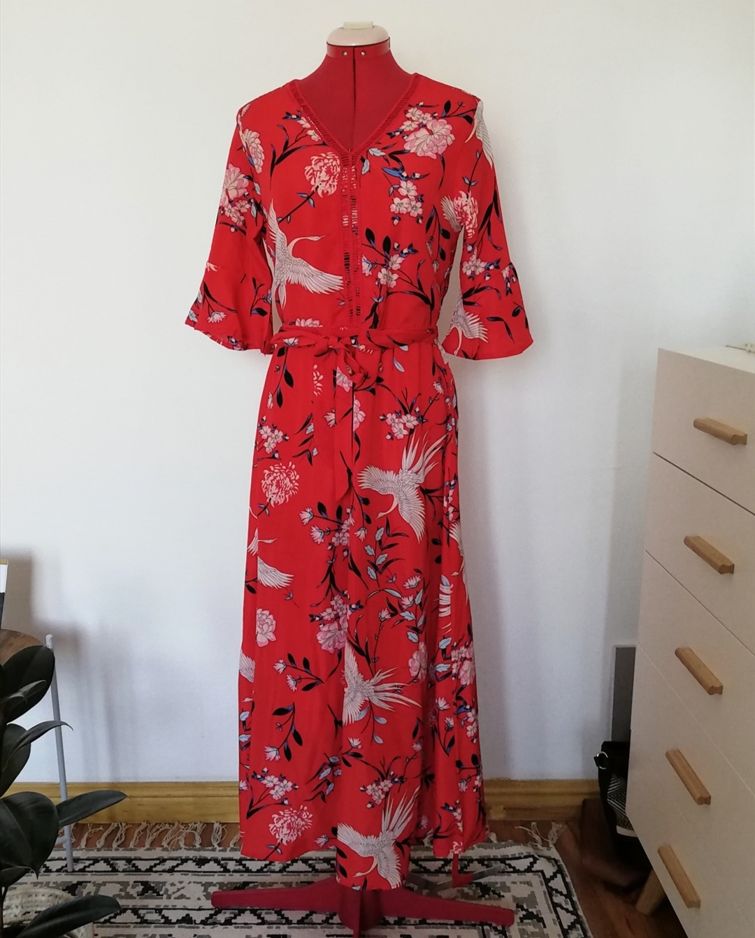 Red printed full-length dress.