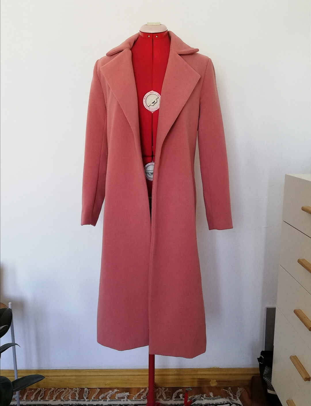 Pink full-length coat.